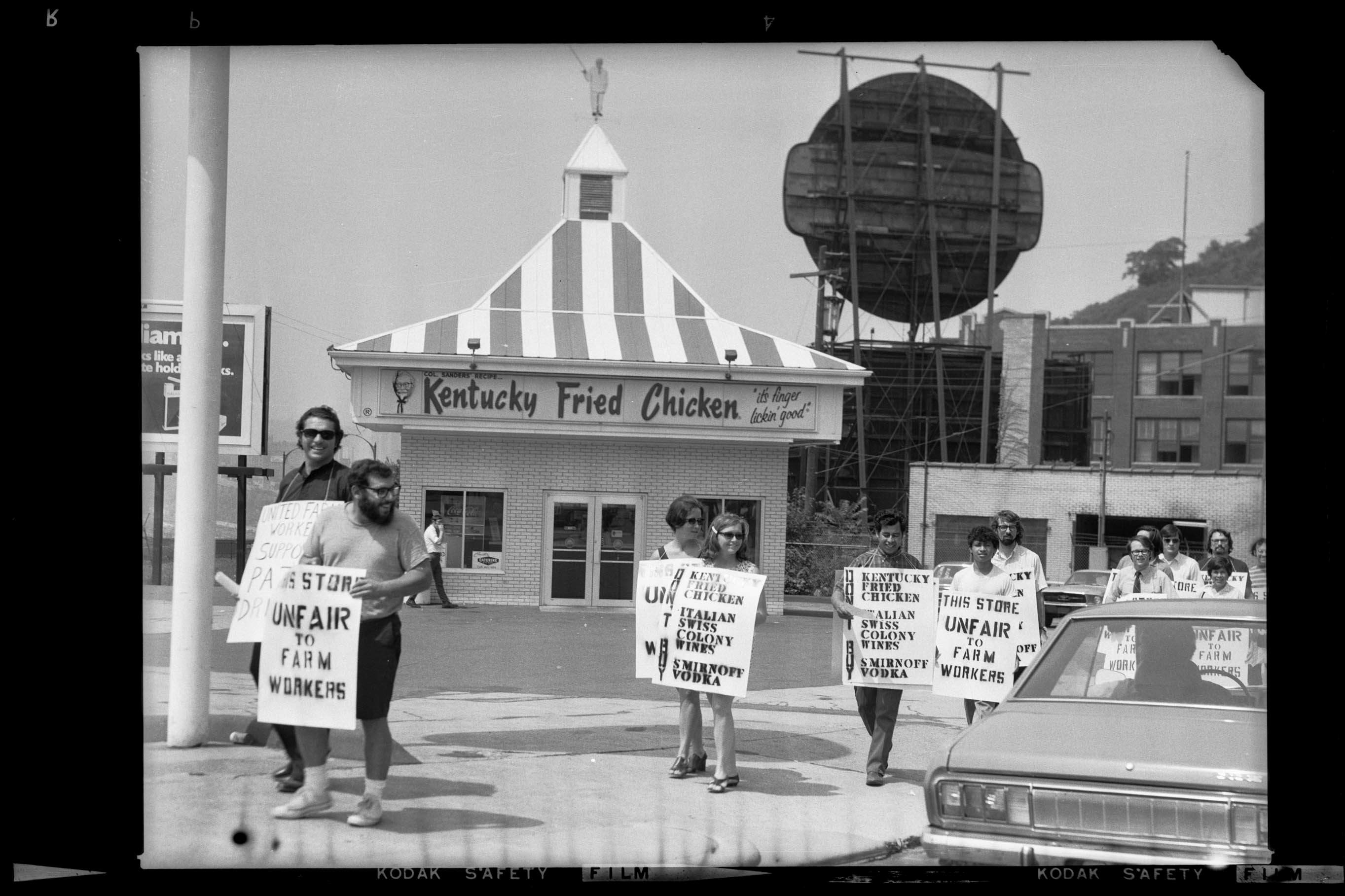 United Farm Workers protesters with sandwich boards reading