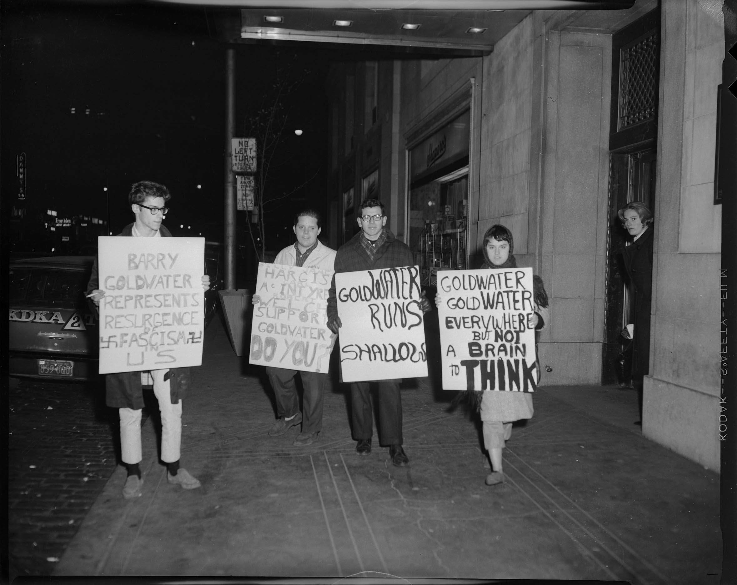 """Protestors holding signs reading """"Barry Goldwater represents resurgence of Fascism..."""