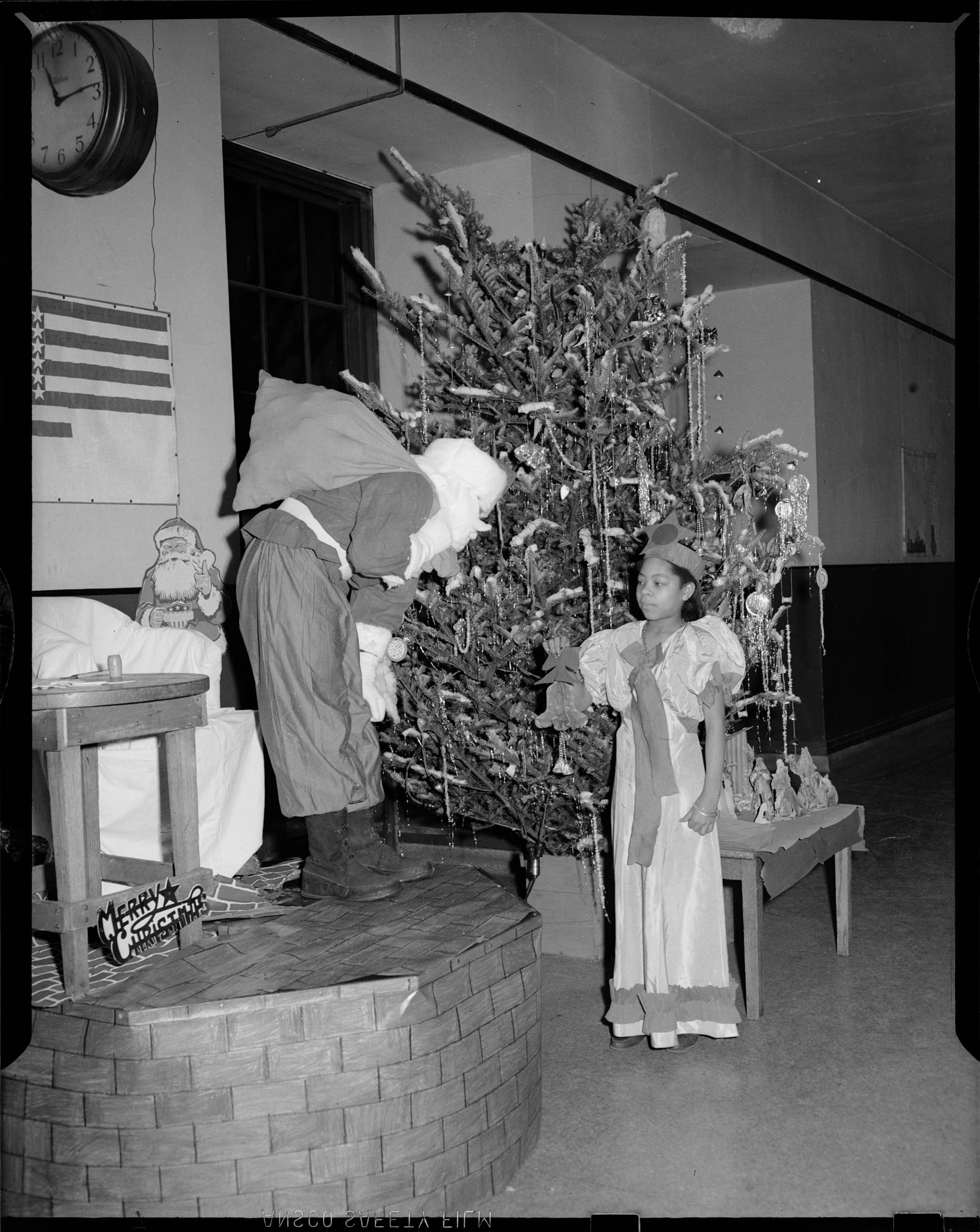 Spirit Of Christmas Past Costume.Man Wearing Santa Claus Costume Standing On Small Stage