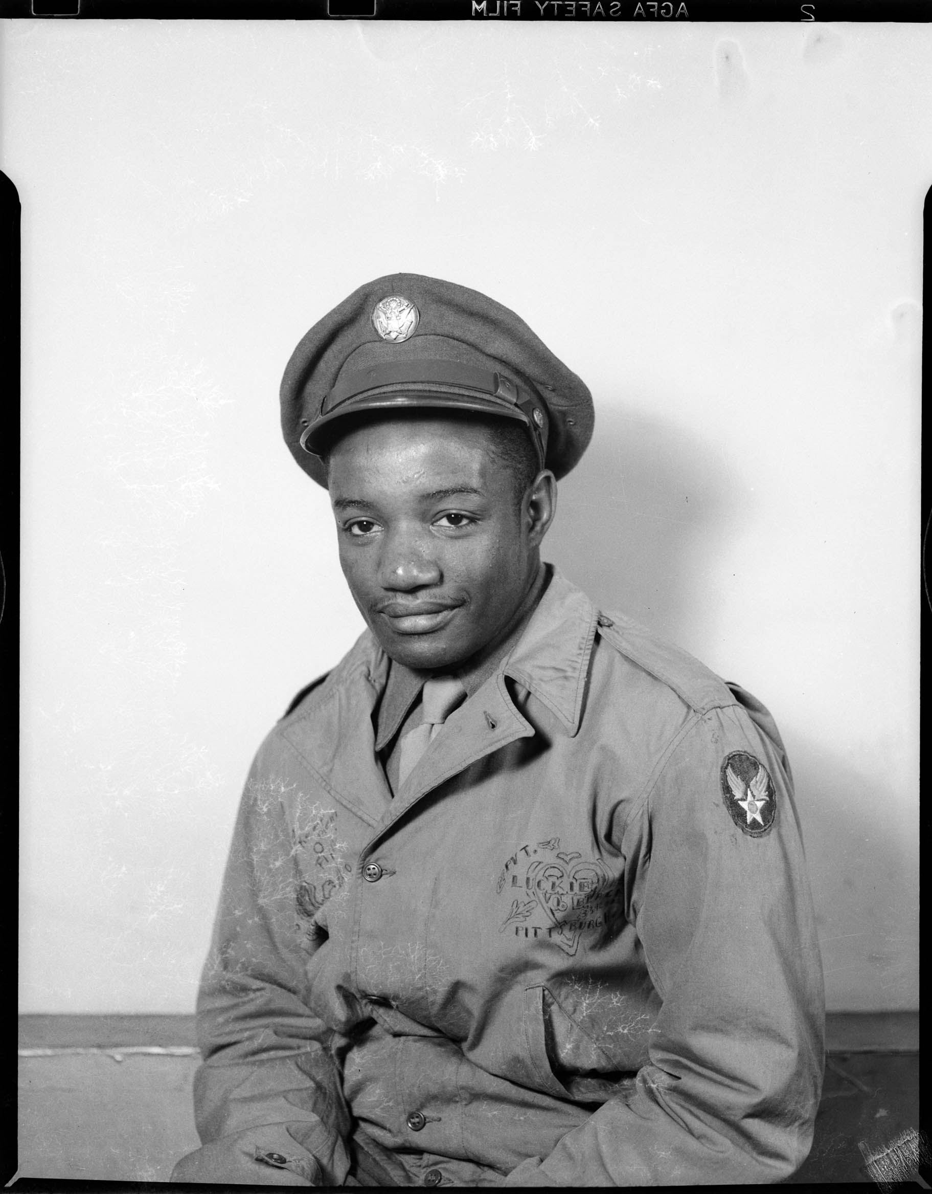 Portrait of Lucky Black wearing U  S  Army uniform with soft sided