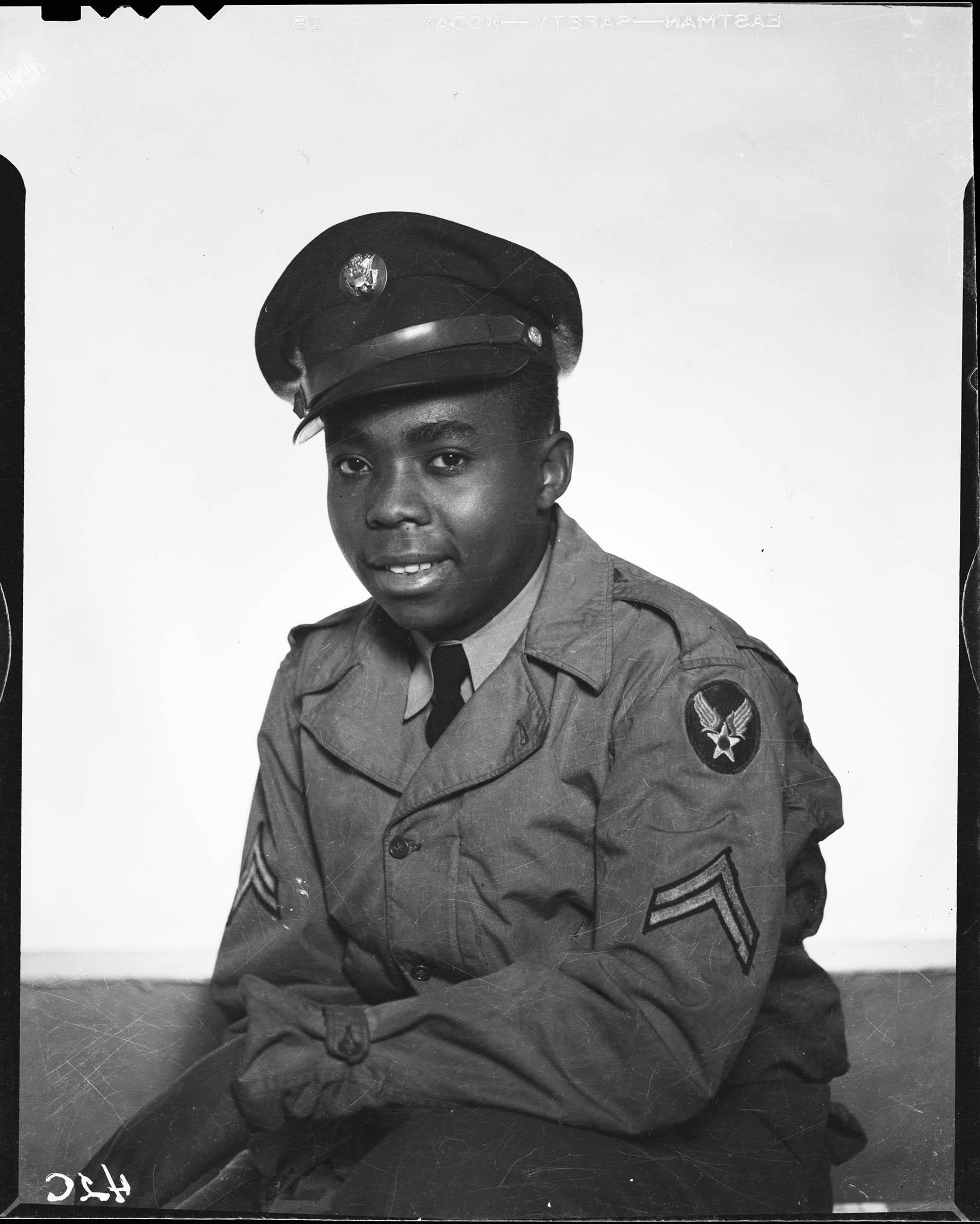 Three quarter portrait of smiling man wearing U S  army