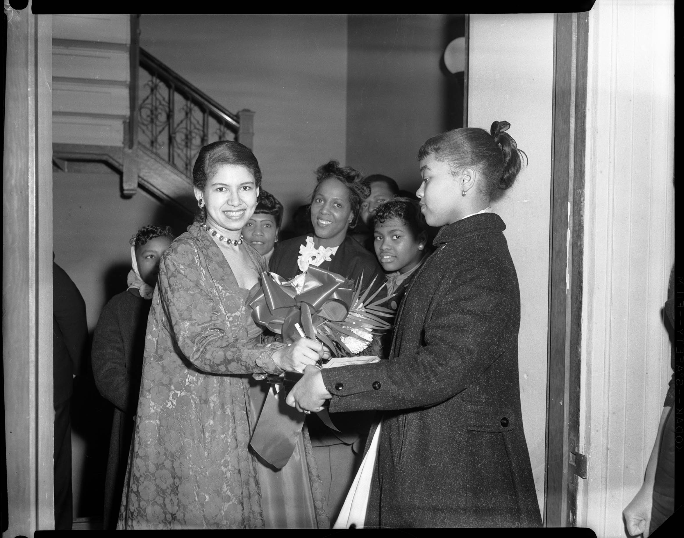 Philippa Duke Schuyler signing autograph for girl, in